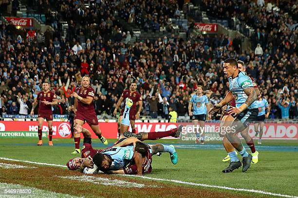 Michael Jennings of the Blues scores the winning try during game three of the State Of Origin series between the New South Wales Blues and the...