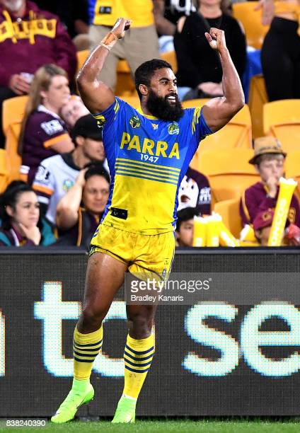 Michael Jennings of the Eels celebrates scoring a try during the round 25 NRL match between the Brisbane Broncos and the Parramatta Eels at Suncorp...