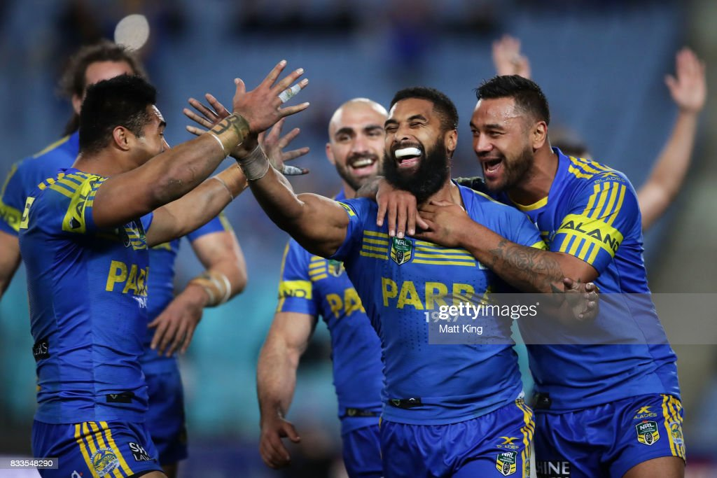 Michael Jennings of the Eels celebrates with team mates after scoring a try that was subsequently disallowed during the round 24 NRL match between the Parramatta Eels and the Gold Coast Titans at ANZ Stadium on August 17, 2017 in Sydney, Australia.