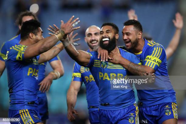 Michael Jennings of the Eels celebrates with team mates after scoring a try that was subsequently disallowed during the round 24 NRL match between...