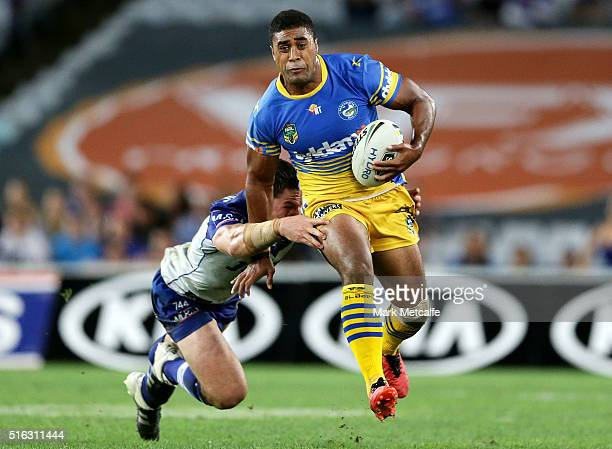 Michael Jennings of the Eels evades the tackle of Josh Jackson of the Bulldogs during the round three NRL match between the Canterbury Bulldogs and...