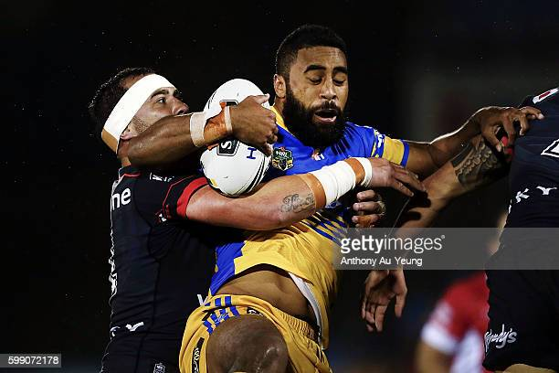 Michael Jennings of the Eels is tackled by Bodene Thompson of the Warriors during the round 26 NRL match between the New Zealand Warriors and the...