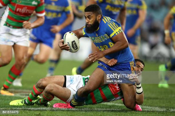 Michael Jennings of the Eels is tackled by Cody Walker of the Rabbitohs during the round 26 NRL match between the Parramatta Eels and the South...