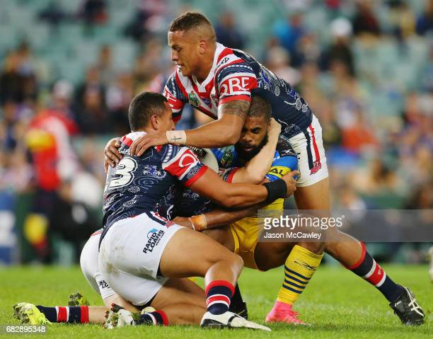 Michael Jennings of the Eels is tackled by Sio Siua Taukeiaho and Kane Evans of the Roosters during the round 10 NRL match between the Sydney...