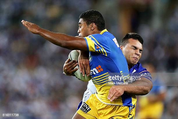 Michael Jennings of the Eels is tackled during the round three NRL match between the Canterbury Bulldogs and the Parramatta Eels at ANZ Stadium on...