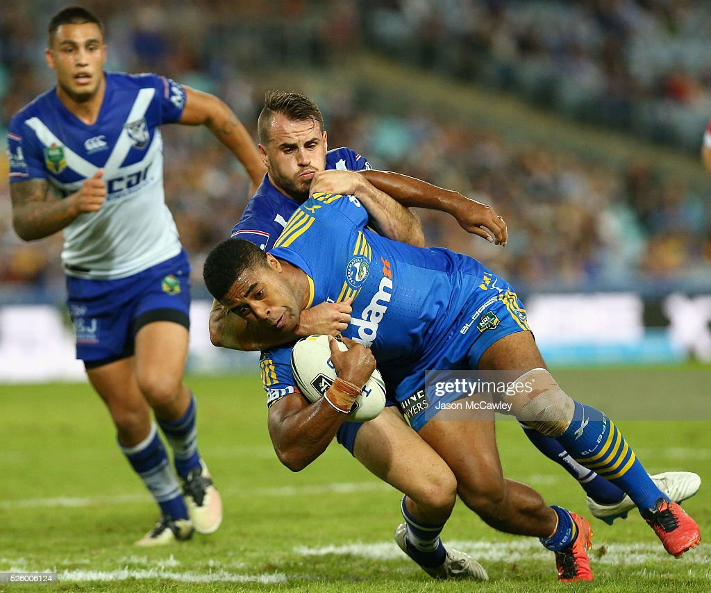 Michael Jennings of the Eels is tackled Josh Reynolds of the Bulldogs during the round nine NRL match between the Parramatta Eels and the Canterbury Bulldogs at ANZ Stadium on April 29, 2016 in Sydney, Australia.
