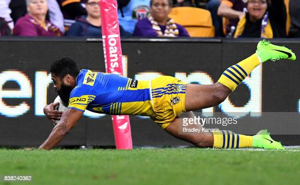 Michael Jennings of the Eels scores a try during the round 25 NRL match between the Brisbane Broncos and the Parramatta Eels at Suncorp Stadium on...