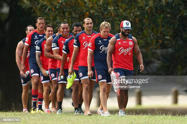 Michael Jennings of the Roosters and team mates walk in single file to a Sydney Roosters NRL training session at Moore Park on March 11 2015 in...