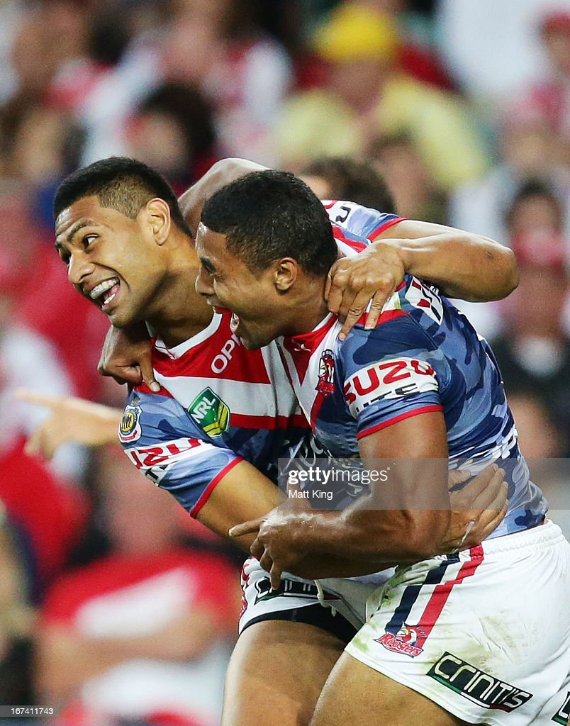 Michael Jennings (R) of the Roosters celebrates with Daniel Tupou (L) after scoring a try during the round seven NRL match between the Sydney Roosters and the St George Illawarra Dragons at Allianz Stadium on April 25, 2013 in Sydney, Australia.