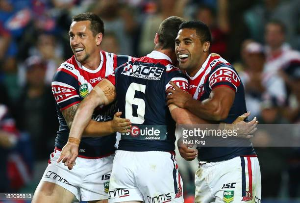 Michael Jennings of the Roosters celebrates with Mitchell Pearce and James Maloney after scoring a try during the NRL Preliminary Final match between...
