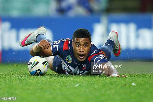 Michael Jennings of the Roosters dives over to score a try during the round 21 NRL match between the Sydney Roosters and the Canterbury Bulldogs at...