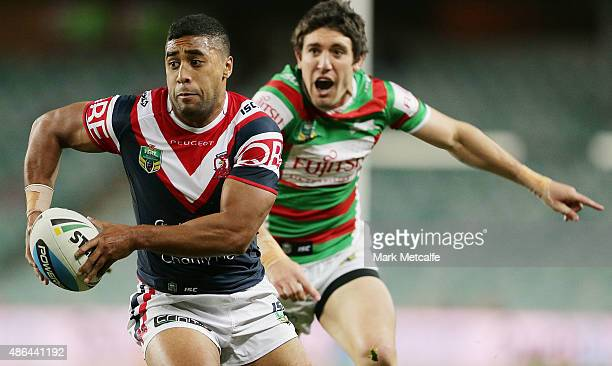 Michael Jennings of the Roosters goes past Joel Reddy of the Rabbitohs to score a try during the round 26 NRL match between the Sydney Roosters and...