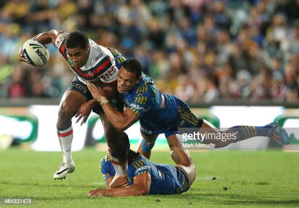 Michael Jennings of the Roosters is tackled by Will Hopoate of the Eels during the round 6 NRL match between the Parramatta Eels and the Sydney...