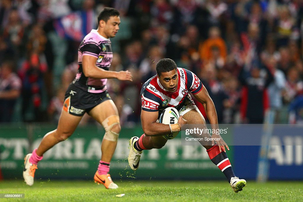 Michael Jennings of the Roosters scores a try during the round nine NRL match between the Sydney Roosters and the Wests Tigers at Allianz Stadium on May 9, 2014 in Sydney, Australia.