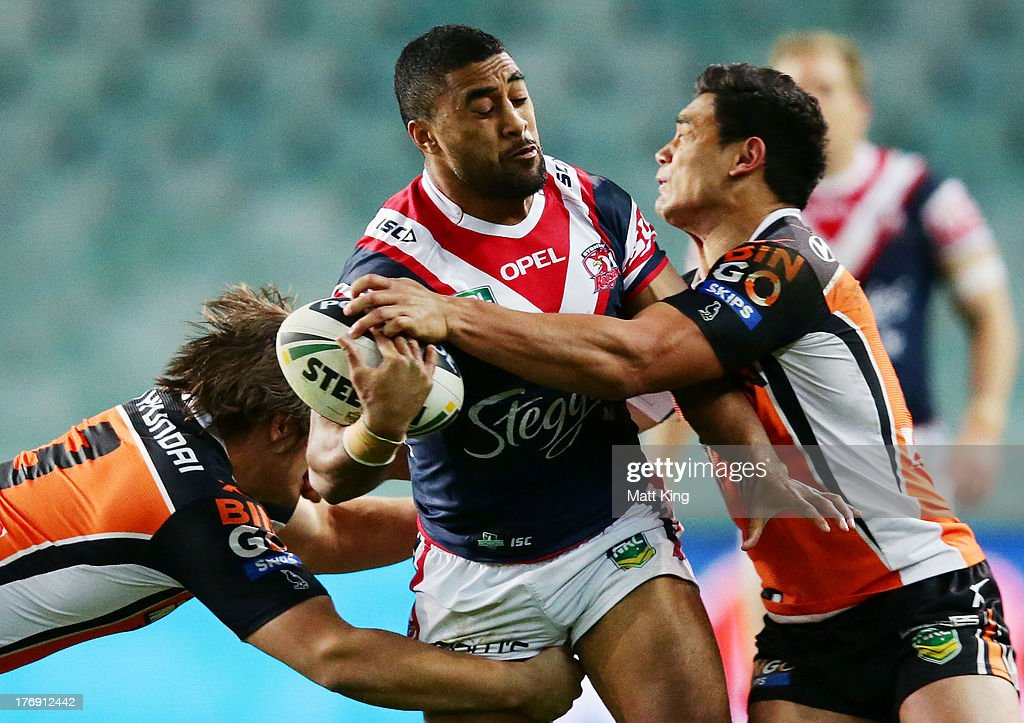 Michael Jennings of the Roosters takes on the defence during the round 23 NRL match between the Wests Tigers and the Sydney Roosters at Allianz Stadium on August 19, 2013 in Sydney, Australia.