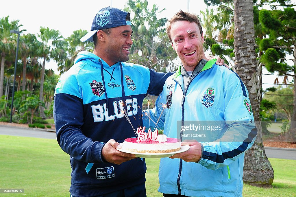 Michael Jennings presents James Maloney with a birthday cake during a New South Wales Blues State of Origin NSW Blues media opportunity on June 15, 2016 in Coffs Harbour, Australia.