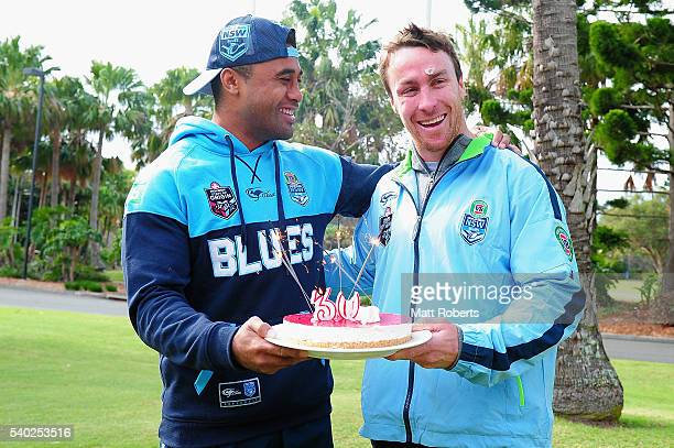 Michael Jennings presents James Maloney with a birthday cake during a New South Wales Blues State of Origin NSW Blues media opportunity on June 15...