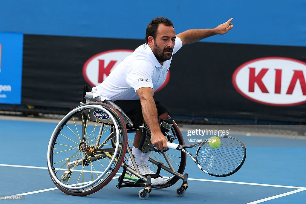Michael Jeremiasz of France plays a shot in their Wheelchair Doubles Final with Shingo Kunieda of Japan against Adam Kellerman of Australia and Stefan Olsson of Sweden at Melbourne Park on January 25, 2013 in Melbourne, Australia.