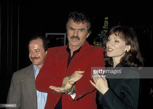 Michael Jeter Burt Reynolds and Marilu Henner during NAPTE Convention January 27 1993 at Moscone Convention Center in San Francisco California United...