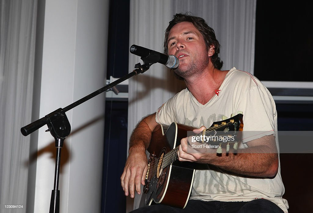 <a gi-track='captionPersonalityLinkClicked' href=/galleries/search?phrase=Michael+Johns&family=editorial&specificpeople=4897964 ng-click='$event.stopPropagation()'>Michael Johns</a> of American Idol sings after the Birdies for Breast Cancer Foundation Liberty Cup at Liberty National Golf Club on August 30, 2011 in Jersey City, New Jersey.