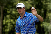 Michael Johnson acknowledges the crowd on the fourteenth green during the final round of the Barbasol Championship at the Robert Trent Jones Golf...
