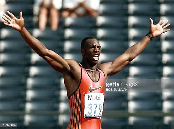 Michael Johnson celebrates his time in the men's 200 meters semifinals 22 June at the US Track and Field trials Johnson finished with a world record...