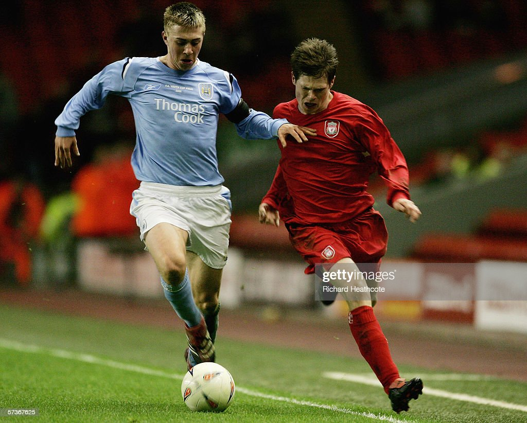 Michael Johnson of Man City holds off Paul Barratt of Liverpool during the FA Youth Cup Final 1st Leg match between Liverpool and Manchester City at...
