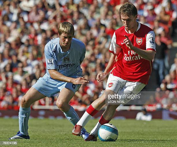 Michael Johnson of Manchester City attempts to tackle Alexander Hleb of Arsenal during the Premiership football match against Arsenal at the Emirates...