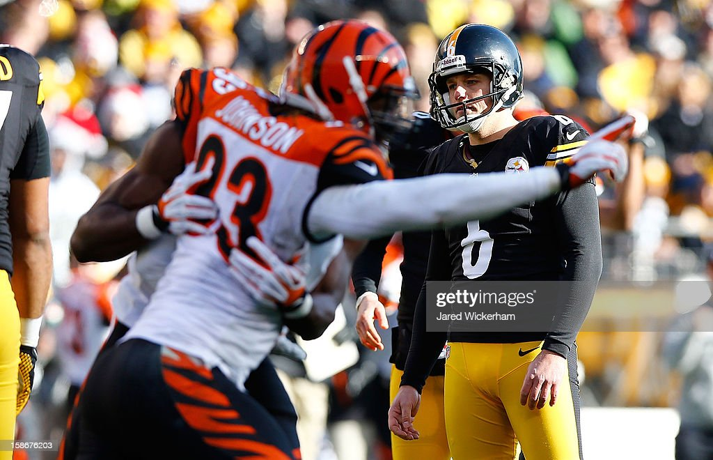 Michael Johnson #93 of the Cincinnati Bengals celebrates after <a gi-track='captionPersonalityLinkClicked' href=/galleries/search?phrase=Shaun+Suisham&family=editorial&specificpeople=756453 ng-click='$event.stopPropagation()'>Shaun Suisham</a> #6 of the Pittsburgh Steelers missed a field goal in the second quarter during the game at Heinz Field on December 23, 2012 in Pittsburgh, Pennsylvania.