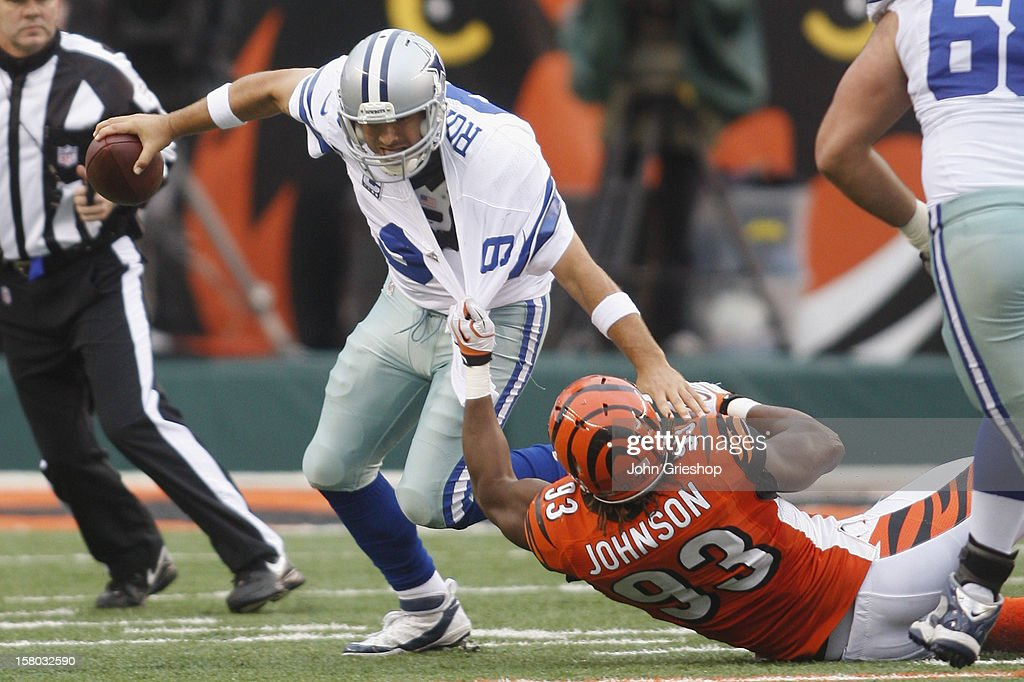 Michael Johnson #93 of the Cincinnati Bengals sacks <a gi-track='captionPersonalityLinkClicked' href=/galleries/search?phrase=Tony+Romo&family=editorial&specificpeople=756503 ng-click='$event.stopPropagation()'>Tony Romo</a> #9 of the Dallas Cowboys during their game at Paul Brown Stadium on December 9, 2012 in Cincinnati, Ohio. The Cowboys defeated the Bengals 20-19.
