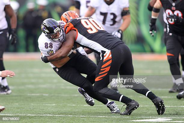 Michael Johnson of the Cincinnati Bengals tackles Dennis Pitta of the Baltimore Ravens during the fourth quarter at Paul Brown Stadium on January 1...