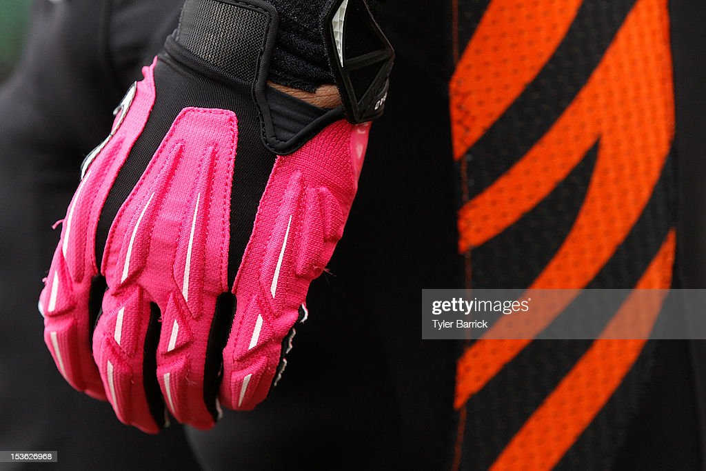 Michael Johnson #93 of the Cincinnati Bengals, wears pink gloves for breast cancer awareness during the game against the Miami Dolphins at Paul Brown Stadium on October 7, 2012 in Cincinnati, Ohio.