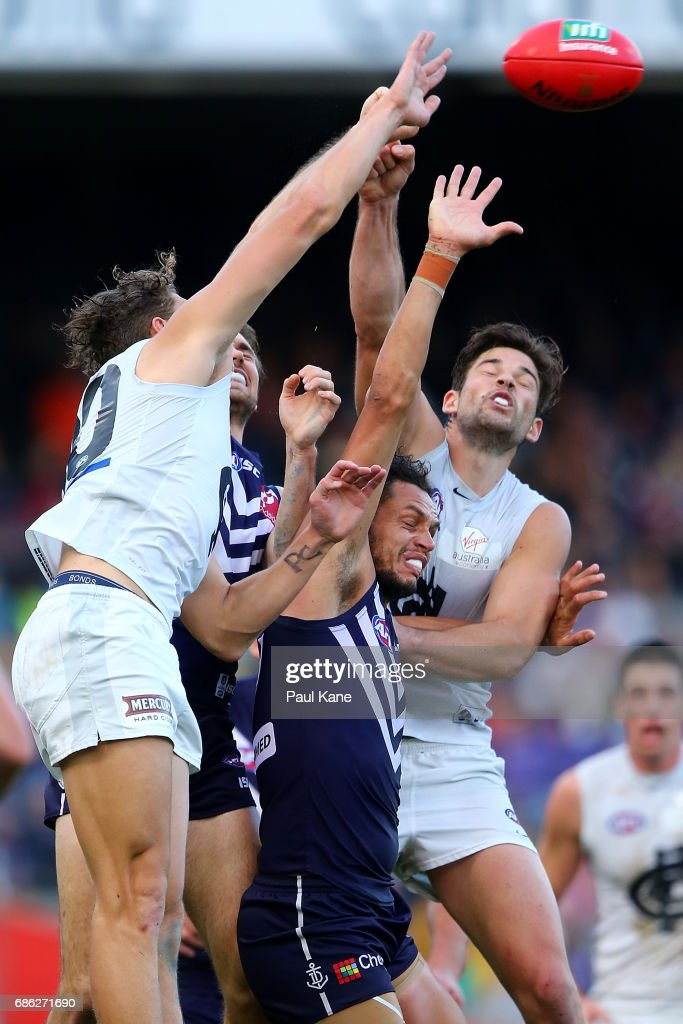 Michael Johnson of the Dockers contests for the ball against Charlie Curnow and Levi Casboult of the Blues during the round nine AFL match between the Fremantle Dockers and the Carlton Blues at Domain Stadium on May 21, 2017 in Perth, Australia.