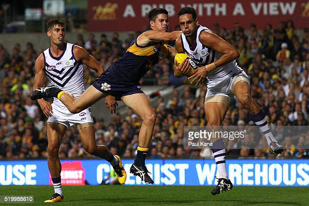 Michael Johnson of the Dockers marks the ball against Liam Duggan of the Eagles during the round three AFL match between the West Coast Eagles and...