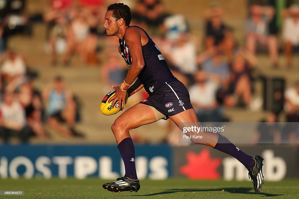Michael Johnson of the Dockers runs with the ball during the NAB Challenge match between the Fremantle Dockers and the Melbourne Demons at Fremantle...