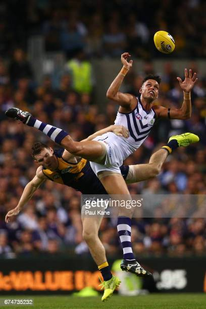 Michael Johnson of the Dockers sets for a mark against Luke Shuey of the Eagles during the round six AFL match between the West Coast Eagles and the...