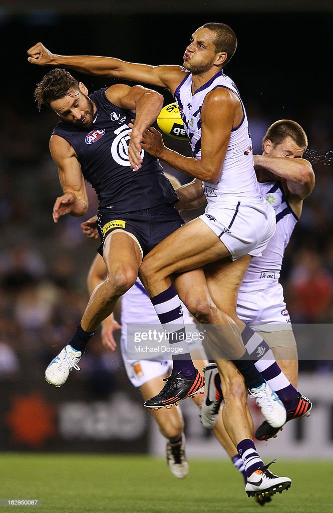 Michael Johnson (C) of the Fremantle Dockers and Andrew Walker of the Carlton Blues contest for the ball during the round two AFL NAB Cup match between the Carlton Blues and the Fremantle Dockers at Etihad Stadium on March 2, 2013 in Melbourne, Australia.