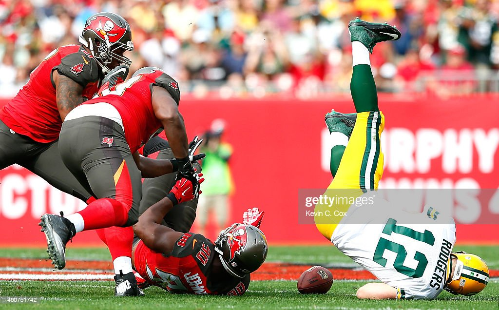 Michael Johnson #90 of the Tampa Bay Buccaneers forces a fumble by Aaron Rodgers #12 of the Green Bay Packers at Raymond James Stadium on December 21, 2014 in Tampa, Florida.