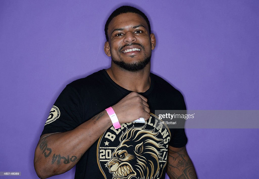 Michael Johnson poses for a portrait after defeating Gleison Tibau in their lightweight bout during the UFC 168 event at the MGM Grand Garden Arena on December 28, 2013 in Las Vegas, Nevada.