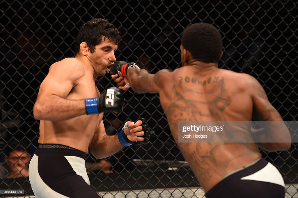 Michael Johnson punches Beneil Dariush in their lightweight bout during the UFC Fight Night event at Bridgestone Arena on August 8, 2015 in Nashville, Tennessee.