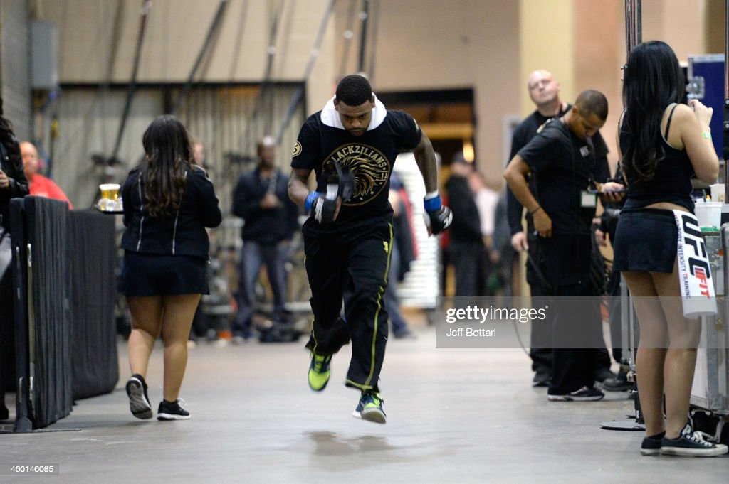 Michael Johnson warms up before his lightweight bout against Gleison Tibau during the UFC 168 event at the MGM Grand Garden Arena on December 28, 2013 in Las Vegas, Nevada.