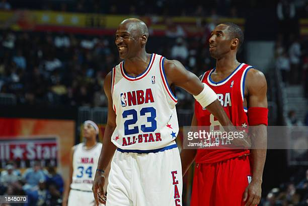 Michael Jordan of the Eastern Conference AllStars jokes with Kobe Bryant of the Western Conference AllStars during the 2003 NBA AllStar Game on...