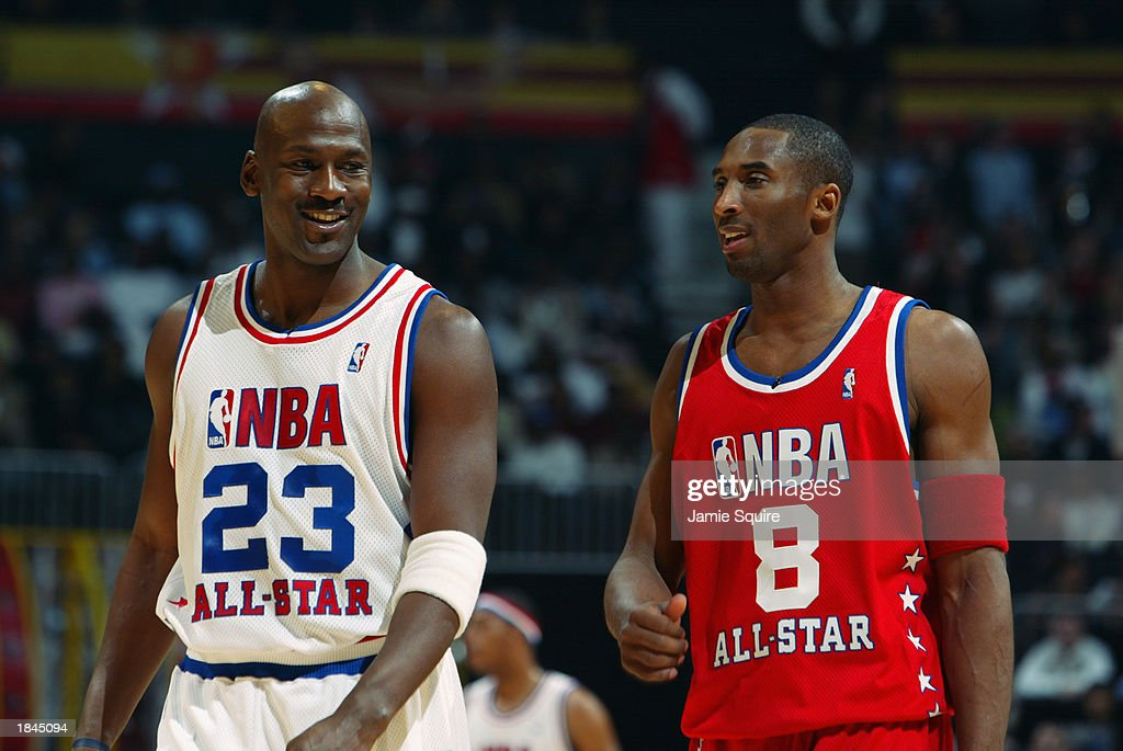 Michael Jordan of the Eastern Conference AllStars talks with Kobe Bryant of the Western Conference AllStars at the 2003 NBA AllStar Game on February...