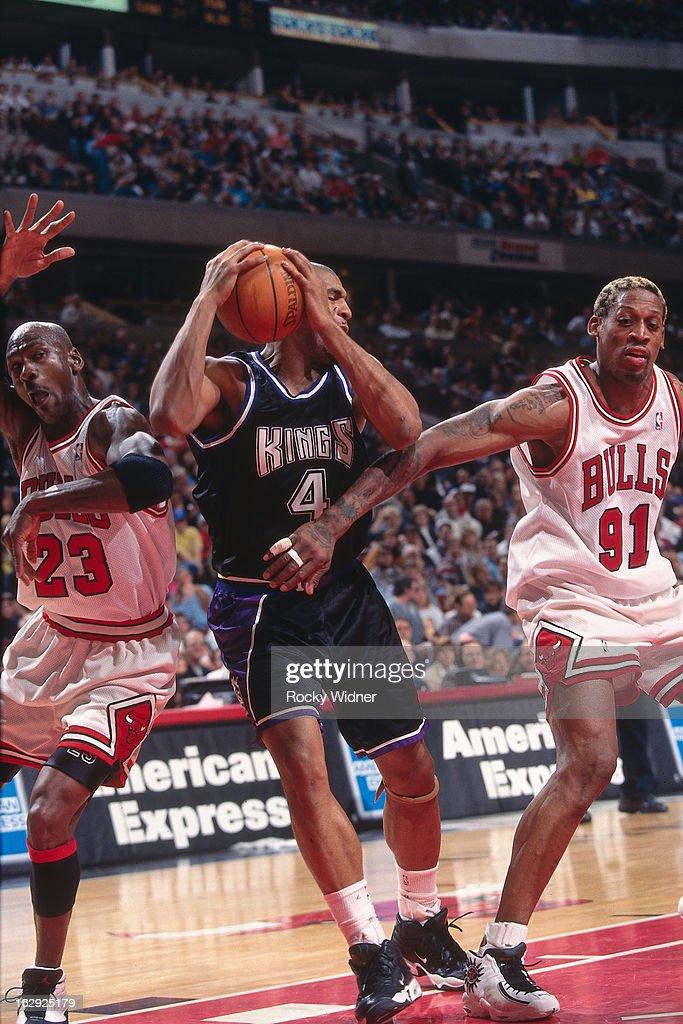 Michael Jordan and Dennis Rodman of the Chicago Bulls battle for position against Corliss Williamson of the Sacramento Kings against the Sacramento...