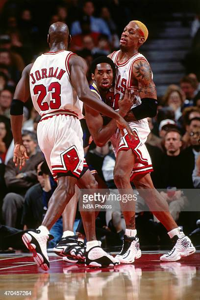Michael Jordan and Dennis Rodman of the Chicago Bulls guard their position against Kobe Bryant of the Los Angeles Lakers on December 17 1997 at the...
