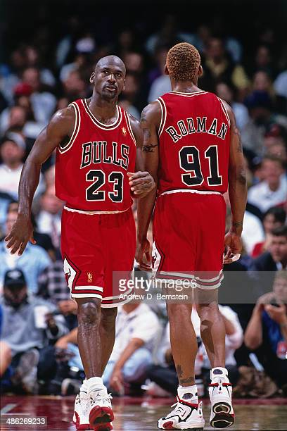 Michael Jordan and Dennis Rodman of the Chicago Bulls look on against the Los Angeles Clippers on November 25 1996 at the LA Sports Arena in Los...