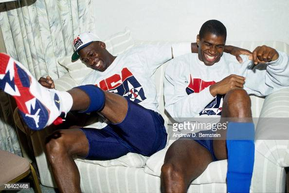 Michael Jordan and Magic Johnson of the United States Basketball Team share a laugh during the 1992 Olympics in Barcelona Spain NOTE TO USER User...