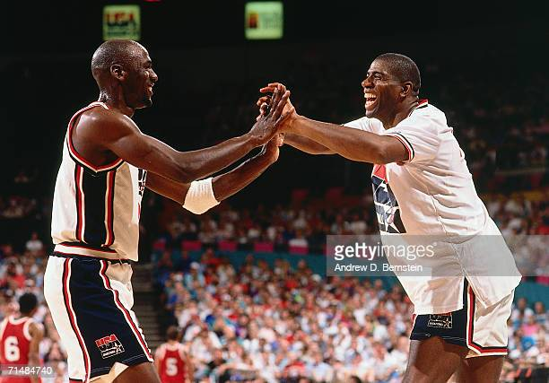 Michael Jordan and Magic Johnson of the United States National Team embrace during the 1992 Summer Olympics in Barcelona Spain NOTE TO USER User...