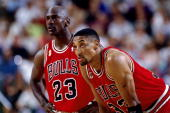Michael Jordan and Scottie Pippen of the Chicago Bulls catch their breath during a 1996 NBA Game NOTE TO USER User expressly acknowledges that by...