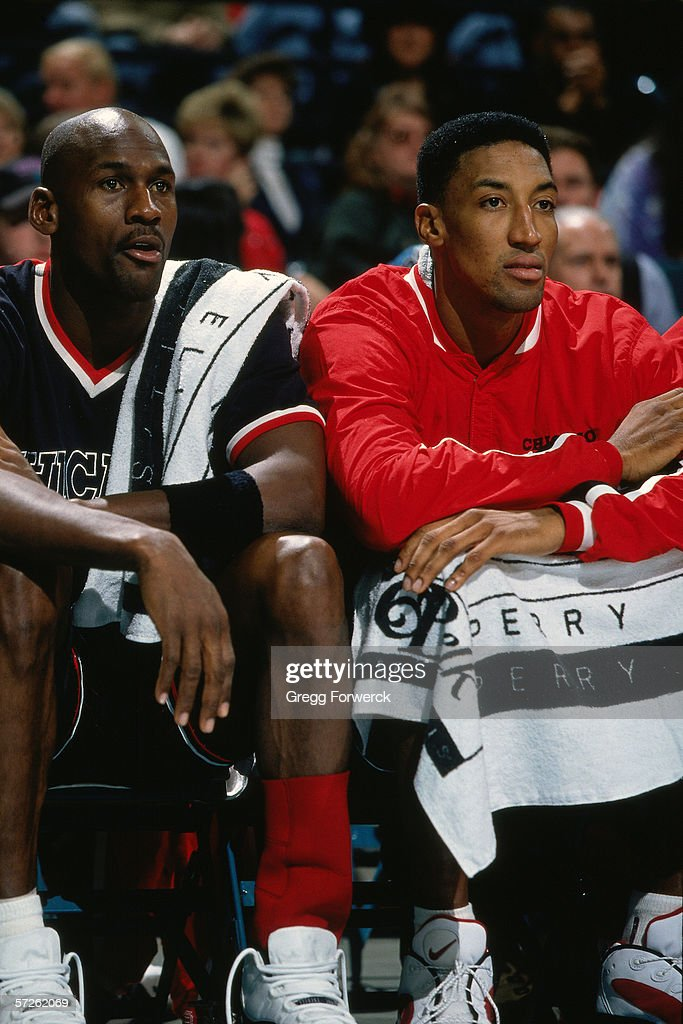 Michael Jordan #23 and Scottie Pippen #33 of the Chicago Bulls watch from the bench during an NBA game against the Charlotte Hornets on January 4, 1996 in Charlotte, North Carolina.